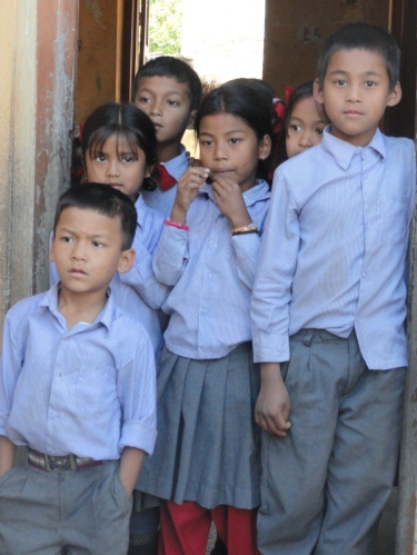 Schoolchildren in Kavre, Nepal watch as we pay a visit to Bhabishva Ujjwal Primary School.