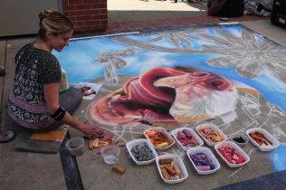 Jessie Steinberg adding many colors to her friendly dog painting.