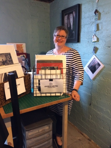 Photographer Michelle Jephcott poses in her newly refurbished artist studio at The Salvage Shop.