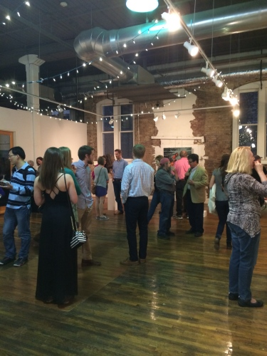 Crowd at the Emporium Center for the Arts on opening night of the Regional Fine Arts Exhibition