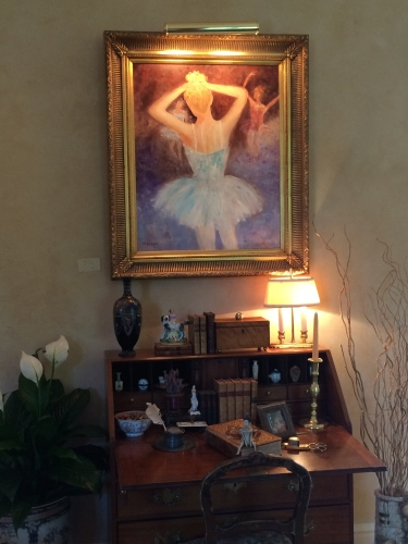 Painting of ballet dancer hangs above a desk in Melanie Wood's living room.