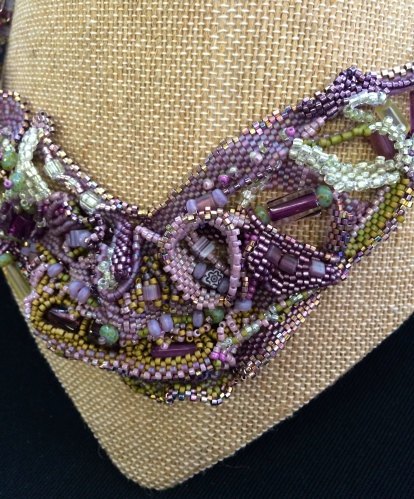 Intricately woven and beaded necklace by Gail DeLuca