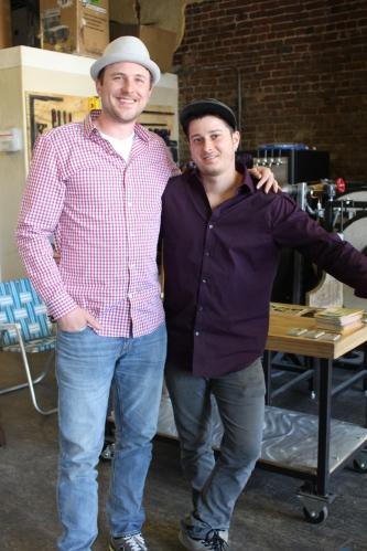 Glass artists Matthew Cummings and Sam Meketon greet guests at Dogwood Art DeTour 2015