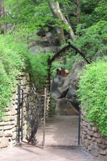 Iron gate leading to Lane Hays's backyard gardens