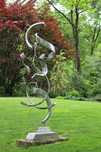With its elegant twists and turns, this sculpture on the front lawn leads the eye beyond to a glimpse of Knoxville from the front lawn of Dr. Solomon's home.