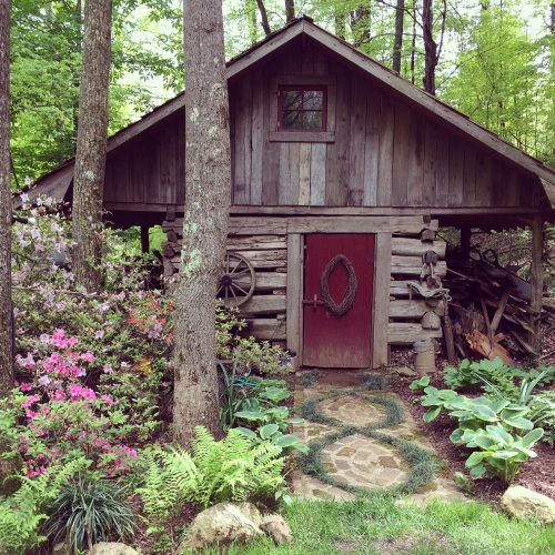 Focal point of Suzie Hall's garden -- this hand-built cabin, moved to this spot and reconstructed.