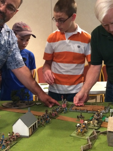 Gaming Club members set up miniature battlefield.