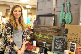 Rachel Converse brought many of her painted-on-burlap sayings to The Traveling Bazaar.