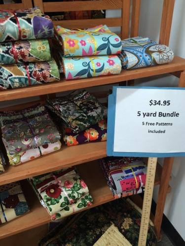 Five-yard bundles line the shelves at Loose Threads in Harriman, TN