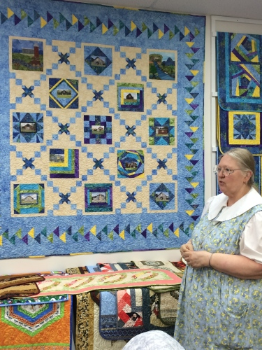 Julia Ranney shows her shop's version of the  East TN barn quilt with the flying geese variation border.  Little Blessings, Crossville, TN