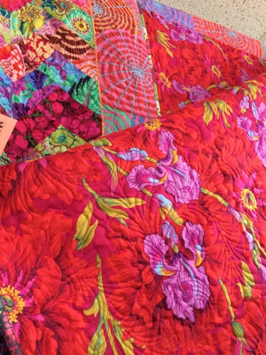 Vivid colors front and back on this quilt designed by Kaffe Fassett.