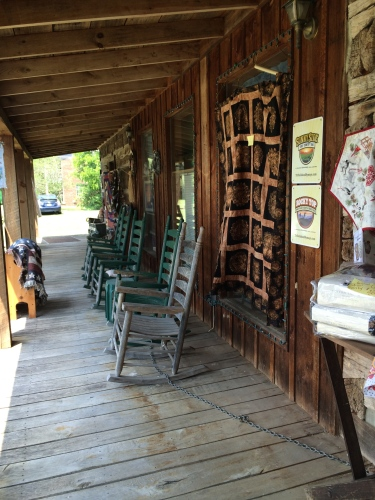 Porch at Holloway's Country Home with covered bridge quilt hanging on the wall.