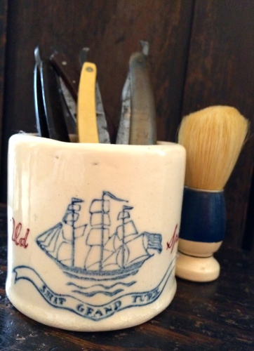 Old Spice mug filled with antique razors
