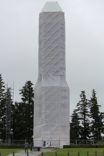 Sheathed in plastic during repairs, the Astoria Column appears to one big gray monolith.