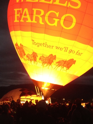 The crowd cheers on the Wells Fargo balloon as it nears lift-off!