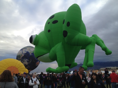 A crowd gathers under the big green frog at Balloon Fiesta 2014.