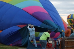 Inflating the balloon with hot air, big fans.