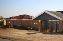 Private home with wall and fence