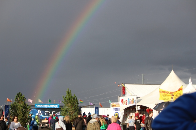 Greatness Awaits says the sign under the rainbow. And you never know . . . balloons may go up or not. Balloon Fiesta's fun anyway.
