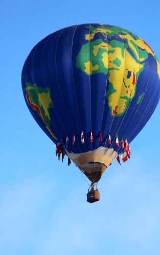 A beautiful globe balloon hits the skies at Albuquerque's Balloon Fiesta 2014.