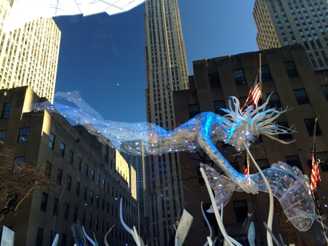 A sea-like mannequin floats magically above undulating waves in a Christmas window at Saks Fifth Avenue.