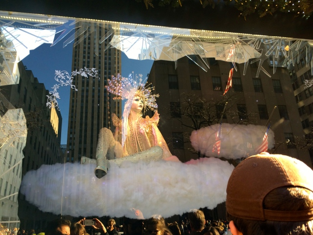 White on white, a mannequin floats atop a cloud at Saks Fifth Avenue, Christmas 2015.