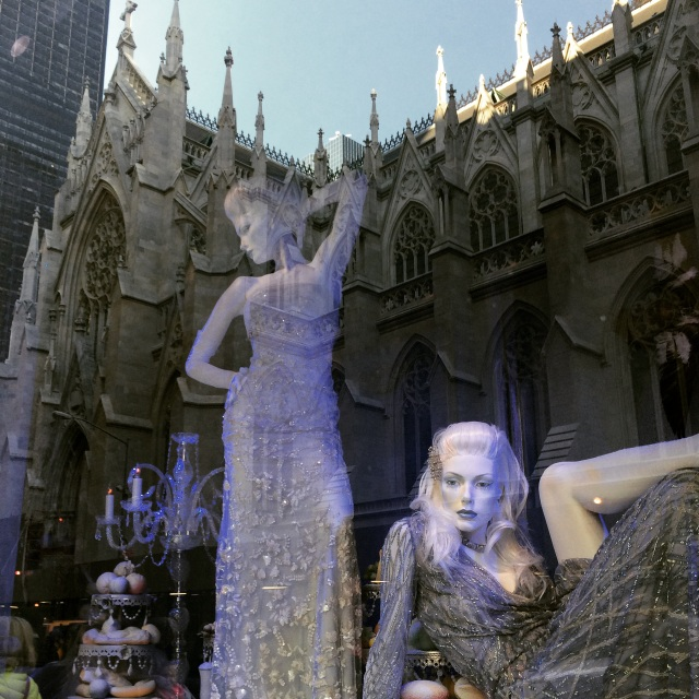 "Two sensuously posed models seem ironically ""surrounded"" by a reflection of St. Patrick's Cathedral."