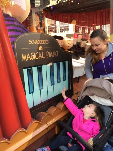 Children stopped to play with the interactive piano at Macy's NYC.  Peanuts music in background!