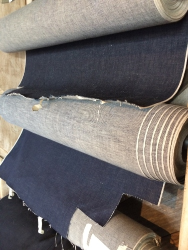 Rolls of raw denim at Marc Nelson Denim ready for cutting and sewing.