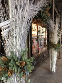 White branches form an interesting entrance for a NYC business.