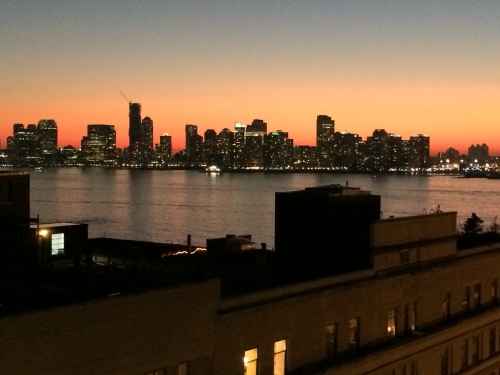 Sundown on the Hudson River as seen from the porch of the Whitney Museum.