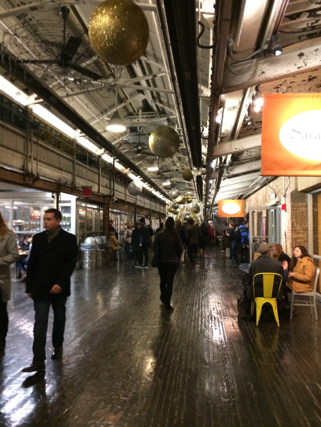 Vendors line the sides of this industrial interior at Chelsea Market.