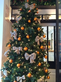 Gold balls, white bows on a hotel Christmas tree in NYC