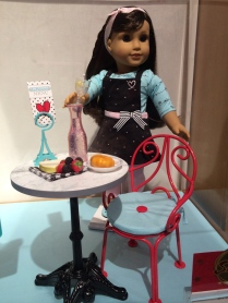 Grace Thomas with her Paris bistro set!