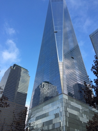 Buildings gleam in sunlight at the 9/11 Memorial Museum site.
