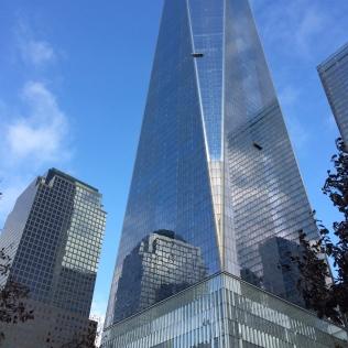 Buildings gleam in sunlight at the 9/11 Memorial Museum site.