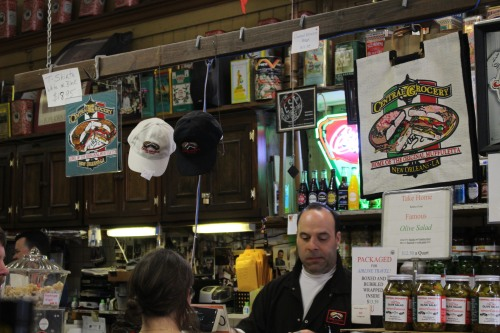 A busy cashier rings up another muffuletta for lunch.
