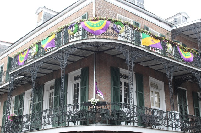 Wrap around, ornamental ironwork on this classic two-story home in the New Orleans French Quarter.