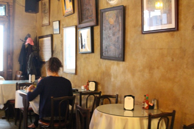 Small tables with white tablecloths await guests in a side room of Napoleon House.