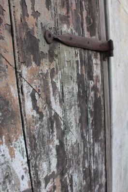 Hand-forged door hinge on weathered door, French Quarter