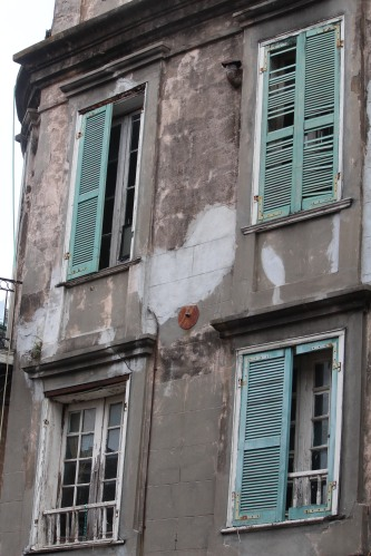 Aged but colorful -- windows on the French Quarter