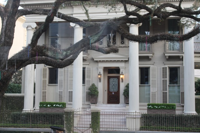 Massive ionic columns frame the doorway in this typical home in the Garden District.