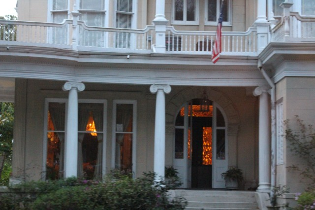 Leaded glass door and transom are aglow in this Garden District beauty.