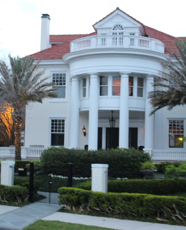 A portico with two-story columns dignifies the entrance to this formal home in the Garden District.