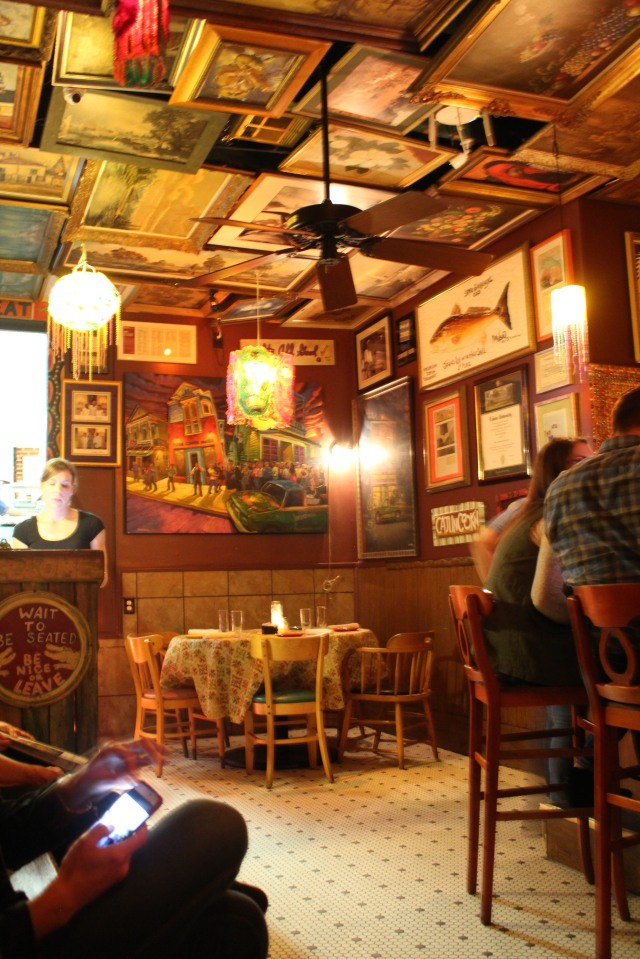 Framed art and who-knows-what-else fill the ceiling and walls at Jacques-Imo's.