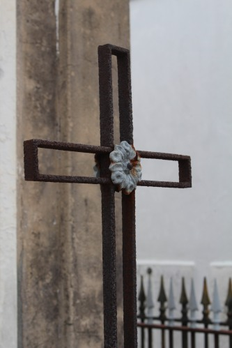 An iron cross in St. Louis Cemetery 1