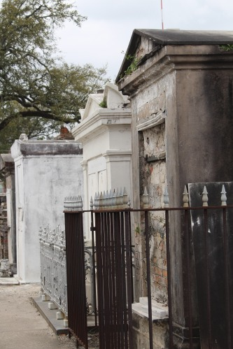 Some tombs remain preserved with ironwork, carving, and architectural details.