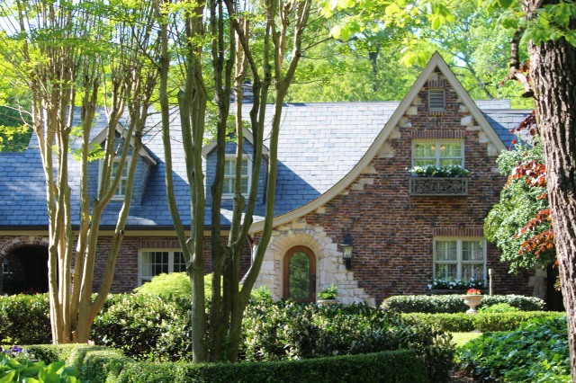Flemish Brick exterior combines with English cottage design elements at home of Dr. Jimmy Milan.