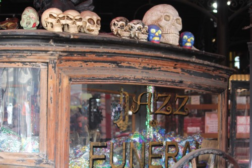 Window scene in The Jazz Funeral on Decatur, New Orleans' French Quarter