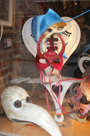 Masks in a store window on Decatur Street, New Orleans